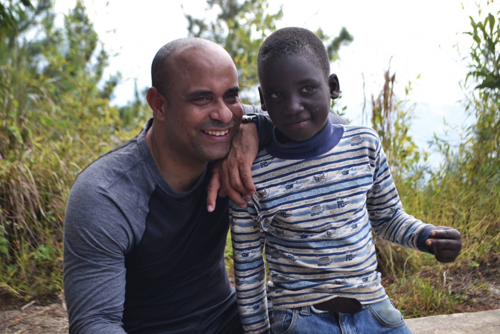Laurent Lamothe helping kid in Haiti with education